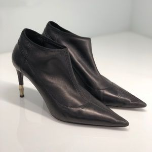 Black Gucci Booties with Gold Heel Detailing